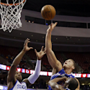 Los Angeles Clippers' Blake Griffin, center, goes up for a shot against Philadelphia 76ers' James Anderson, right, and Lavoy Allen during the first half of an NBA basketball game, Monday, Dec. 9, 2013, in Philadelphia The Associated Press