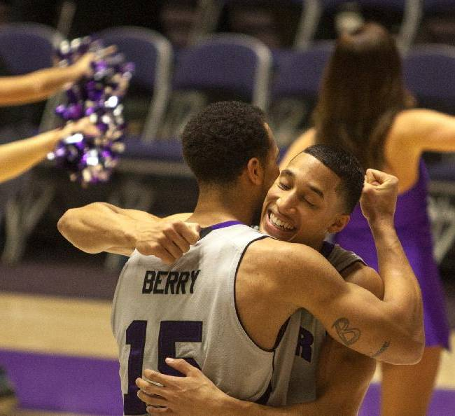 Weber State University's Jeremy Senglin, right, and Davion Berry react after defeating Eastern Washington University during an NCAA college basketball game,  Thursday, Jan. 2, 2014, in Ogden, Utah
