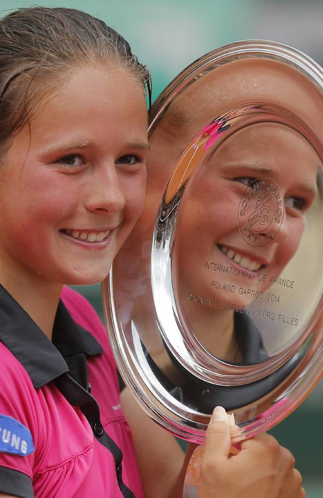 Russia's Darya Kasatkina holds her trophy after winning the junior girls' final match against Serbia's Ivana Jorovic of  the French Open tennis tournament at the Roland Garros stadium, in Paris, France, Saturday, June 7, 2014. Kasatkina won 6-7, 6-2, 6-3