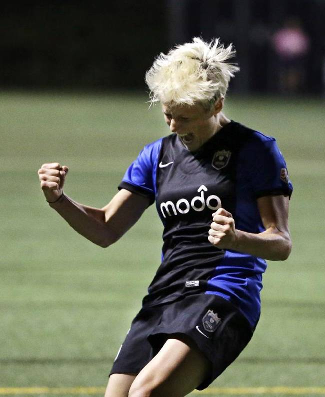 Seattle Reign FC's Megan Rapinoe celebrates after scoring against the Washington Spirit's in the second half of an NWSL semifinal soccer match Sunday, Aug. 24, 2014, in Seattle. The Reign won 2-1
