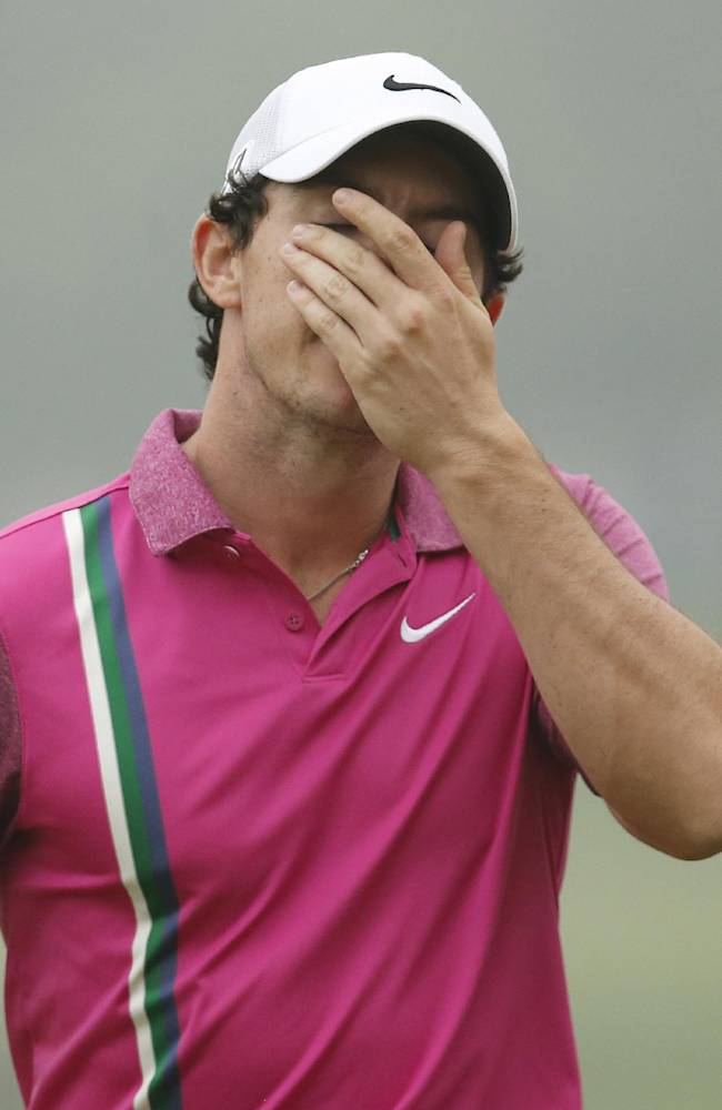 Rory McIlroy of Northern Ireland wipes his face after finishing the HSBC Champions golf tournament at the Sheshan International Golf Club in Shanghai, China, Sunday, Nov. 3, 2013