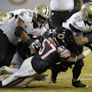 Chicago Bears outside linebacker Jon Bostic (57) tackles New Orleans Saints running back Mark Ingram (22) during the first half of an NFL football game Monday, Dec. 15, 2014, in Chicago The Associated Press