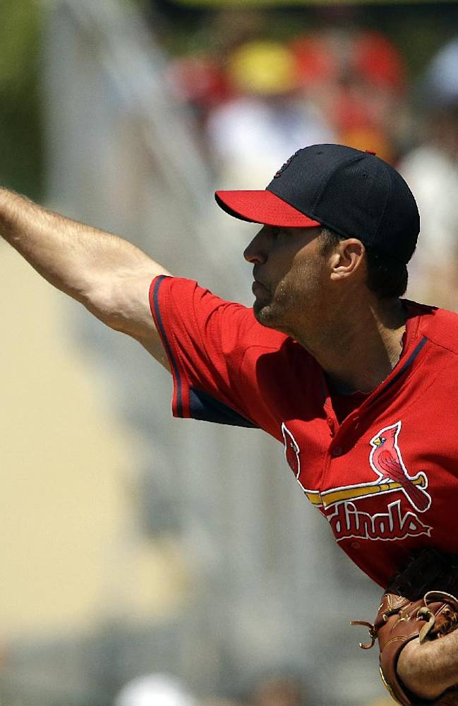 St. Louis Cardinals starting pitcher Adam Wainwright throws in the second inning of an exhibition spring training baseball game against the Washington Nationals, Wednesday, March 26, 2014, in Jupiter, Fla