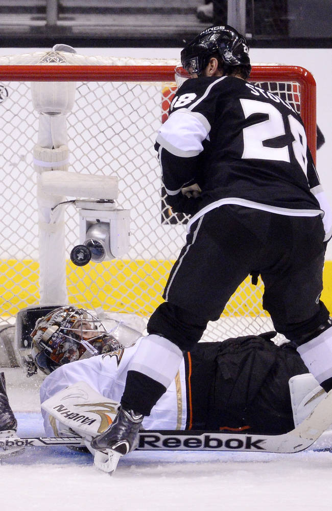 Anaheim Ducks goalie John Gibson, below, stops a shot as Los Angeles Kings center Jarret Stoll looks on during the second period in Game 4 of an NHL hockey second-round Stanley Cup playoff series, Saturday, May 10, 2014, in Los Angeles