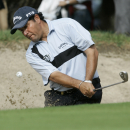 Ricardo Gonzalez of Argentina hits the ball from a bunker on hole 13 during the Madrid Masters Golf championship at the Club de Campo Villa de Madrid, in Madrid, Sunday, Oct. 12, 2008. Gonzalez finished second after South Africa's Charl Schwartzel. (AP Photo/Victor R. Caivano)