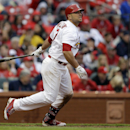 St. Louis Cardinals' Matt Holliday watches his RBI-double during the seventh inning of a baseball game against the Cincinnati Reds Monday, April 7, 2014, in St. Louis. The Cardinals won 5-3 The Associated Press