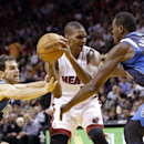 Miami Heat center Chris Bosh, center, looks for an opening past Dallas Mavericks guard Jose Calderon, left, of Spain and center Samuel Dalembert, of Haiti, during the first half of an NBA basketball game Friday, Nov. 15, 2013, in Miami The Associated Pres