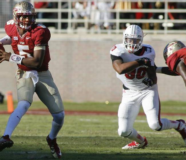 Florida State quarterback Jameis Winston (5) makes a cut to avoid a sack by North Carolina State defensive end Mike Rose (90) in the second quarter of an NCAA college football game on Saturday, Oct. 26, 2013, in Tallahassee, Fla
