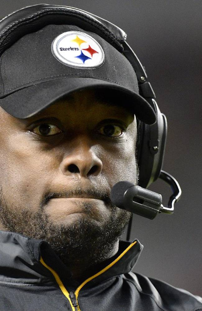 Pittsburgh Steelers head coach Mike Tomlin walks the sideline as his team is losing to the Chicago Bears in the fourth quarter of an NFL football game on Sunday, Sept. 22, 2013, in Pittsburgh. The Steelers lost 40-23