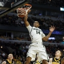 Michigan State's Gary Harris dunks during the second half of an NCAA college basketball game at the Big Ten tournament against Iowa Friday, March 15, 2013, in Chicago. Michigan State won 59-56. (AP Photo/Charles Rex Arbogast)