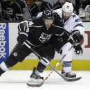 Los Angeles Kings' Dwight King (74) works against San Jose Sharks' Brent Burns (88) during the second period of an NHL hockey game Wednesday, Jan. 21, 2015, in San Jose, Calif The Associated Press