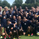 A day aftertheir soccer match was canceled because of violent protests in Charlottesville, Va., the University of Virginia men's soccer team came together for a groupphoto. (University of Virginia Athletics)