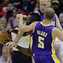Houston Rockets' James Harden, left, is trapped between Los Angeles Lakers' Steve Blake (5) and Chris Kaman during the first quarter of an NBA basketball game Thursday, Nov. 7, 2013, in Houston The Associated Press