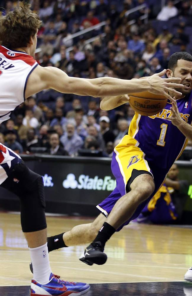 Los Angeles Lakers guard Jordan Farmar (1) drives between Washington Wizards forward Jan Vesely (24), from the Czech Republic, and guard Garrett Temple (17) in the first half of an NBA basketball game Tuesday, Nov. 26, 2013, in Washington