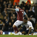Burnley's Ross Wallace, left, takes the ball away from Tottenham's Danny Rose during the English FA Cup third round replay soccer match between Tottenham Hotspur and Burnley at the White Hart Lane stadium in London, Wednesday, Jan. 14, 2015