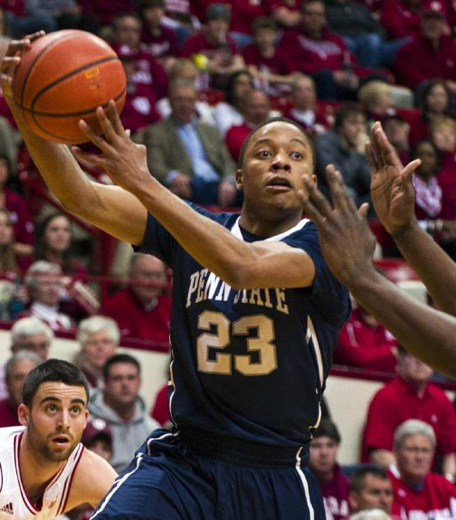 Penn State's Tim Frazier (23) passes the ball to a teammate from under the basket in the first half of an NCAA college basketball game against Indiana, Wednesday, Feb. 12, 2014, in Bloomington, Ind