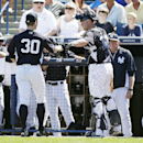 New York Yankees relief pitcher David Robertson (30) is greeted by catcher Brian McCann after pitching the fourth inning of an exhibition baseball game against the Washington Nationals, Monday, March 3, 2014, in Tampa, Fla The Associated Press