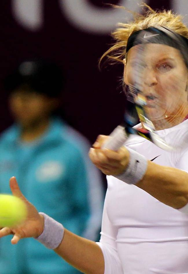 Lucie Safarova of the Czech Republic returns the ball to her compatriot Petra Kvitova during the fourth day of the WTA Qatar Ladies Open in Doha, Qatar,Thursday, Feb. 13, 2014