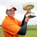 Peter Uihlein, of the US, holds his trophy after winning the Madeira Islands Open Sunday, May 19, 2013, at the Santo da Serra golf course, in Machico, Portugal. Uihlein shot a 15-under-par total of 273. (AP Photo/Helder Santos)