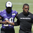 In this July 31, 2014, file photo, Baltimore Ravens running back Ray Rice, right, walks off the field with Justin Forsett before addressing the media at a news conference in Owings Mills, Md. The Ravens have cut Ray Rice. Hours after the release of a vide