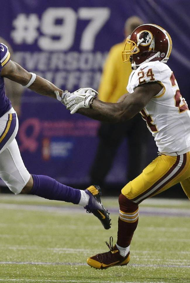Minnesota Vikings wide receiver Joe Webb, left, runs from Washington Redskins strong safety Bacarri Rambo during the first half of an NFL football game Thursday, Nov. 7, 2013, in Minneapolis