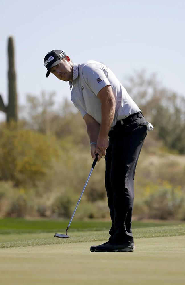 Hunter Mahan putts on the 10th hole in his second-round match against Richard Sterne, of South Africa, at the Match Play Championship golf tournament Thursday, Feb. 20, 2014, in Marana, Ariz