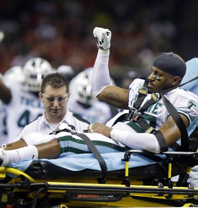 Tulane cornerback Jordan Sullen waves to the crowd as he leaves the field after being injured against Louisiana-Lafayette during the second half of the New Orleans Bowl NCAA college football game, in New Orleans, Saturday, Dec. 21, 2013