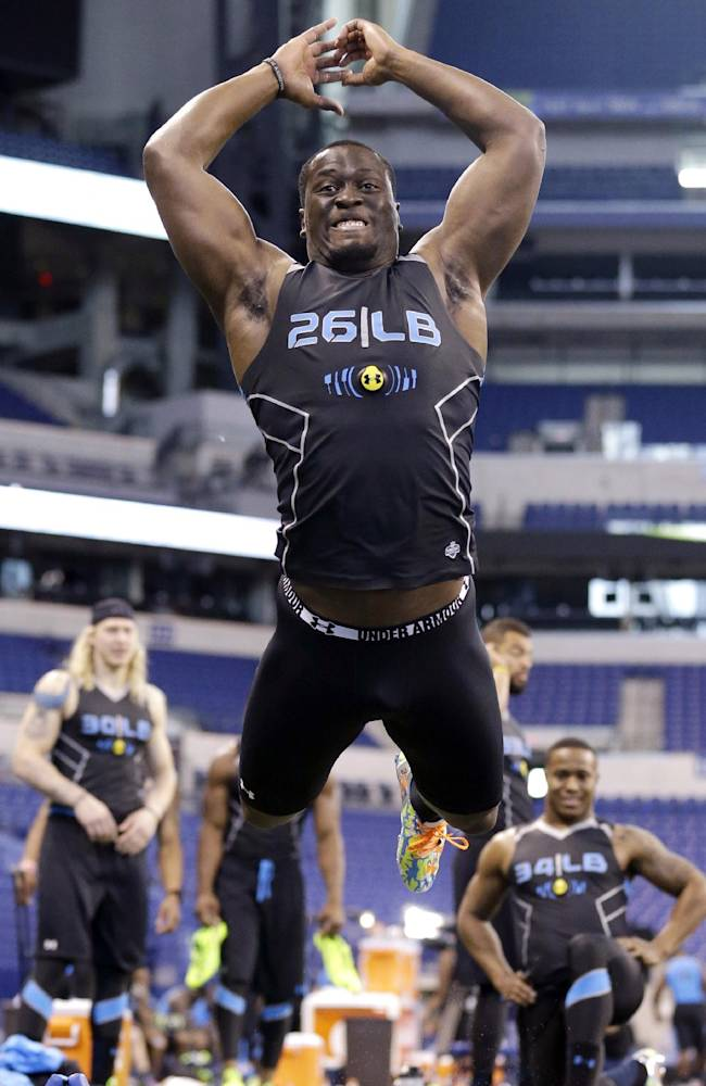 Notre Dame linebacker Prince Shembo jumps a long jump test during a drill at the NFL football scouting combine in Indianapolis, Monday, Feb. 24, 2014