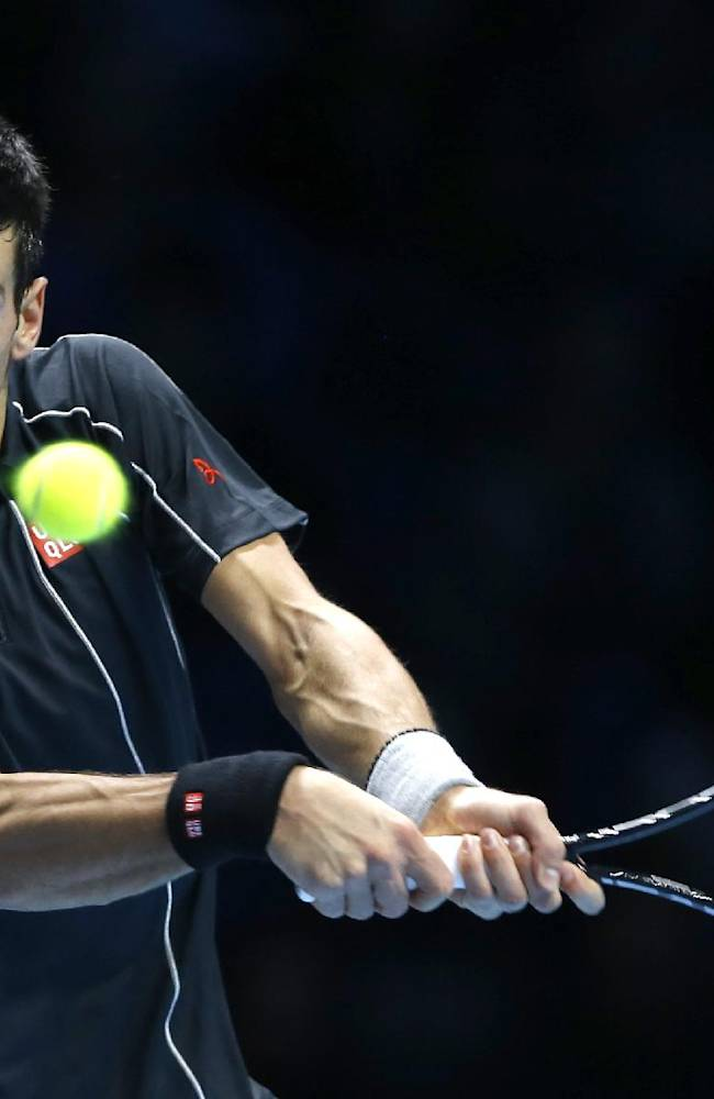 Novak Djokovic of Serbia plays a return to Rafael Nadal of Spain during the final of the ATP World Tour Finals at the O2 Arena in London, Monday, Nov. 11, 2013