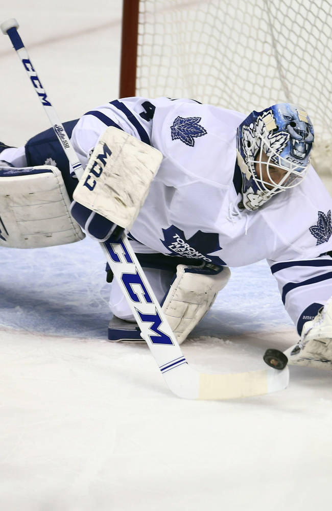 Toronto Maple Leafs goalie Jonathan Bernier blocks a Florida Panthers shot-on-goal during the second period of an NHL hockey game in Sunrise, Fla., Tuesday,  Feb. 4, 2014
