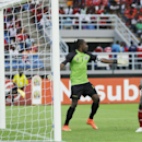Congo's Fode Dore, right, reacts after scoring a goal against Democratic Republic of Congo's goalkeeper Robert Muteba Kidiaba, left, during their African Cup of Nations quarter final soccer match in Bata, Equatorial Guinea, Saturday, Jan. 31, 2015. (AP Photo/Themba Hadebe)