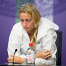 Petra Kvitova of the Czech Republic looks down during a press conference after being defeated by Jelena Jankovic of Serbia in their singles match at the All England Lawn Tennis Championships in Wimbledon, London, Saturday July 4, 2015. (Javier Garcia/AELTC Pool via AP)