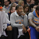New York Knicks' Carmelo Anthony, left, J.R. Smith, center, and Amar'e Stoudemire, right, watch their team play during the first half of an NBA basketball game against the Philadelphia 76ers Monday, March 10, 2014, in New York The Associated Press