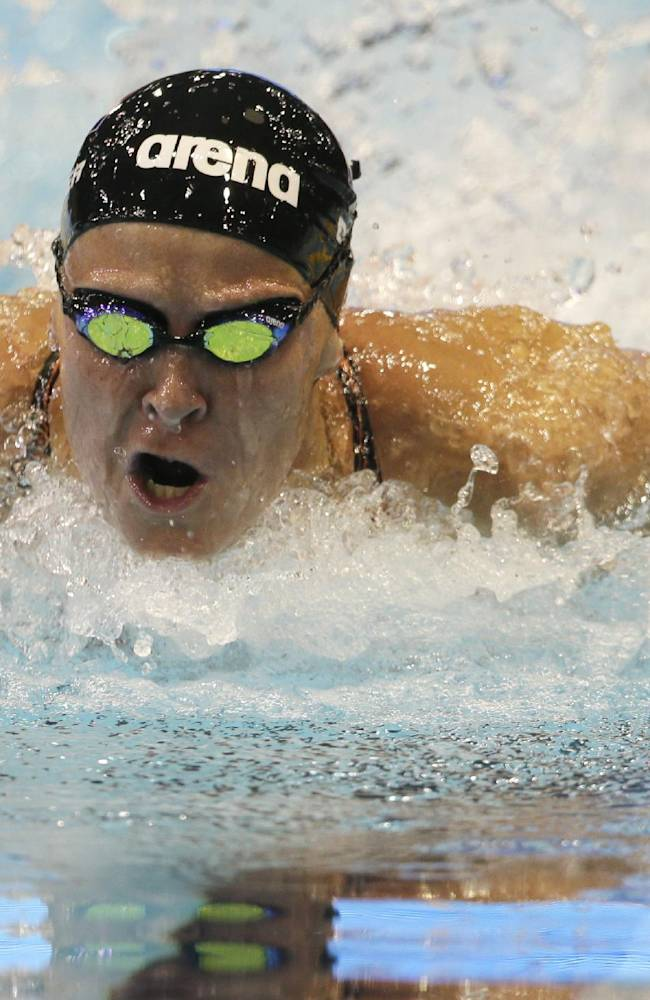 Netherlands' Inge Dekker competes in a women's 100m butterfly first round heat at the LEN Swimming European Championships in Berlin, Germany, Thursday, Aug. 21, 2014