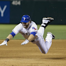 Texas Rangers' Mitch Moreland dives headfirst into third base for a triple against the Philadelphia Phillies during the seventh inning of a baseball game on Wednesday, April 2, 2014, in Arlington, Texas The Associated Press