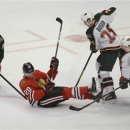 Chicago Blackhawks left wing Brandon Saad is surrounded by Minnestoa players  in Game 1 of an NHL hockey Stanley Cup playoff