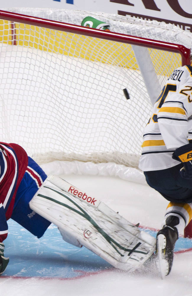 Buffalo Sabres' Mikhail Grigorenko, right, scores against Montreal Canadiens goaltender Zachary Fucale during shootout of an NHL preseason hockey game in Montreal, Sunday, Sept. 15, 2013
