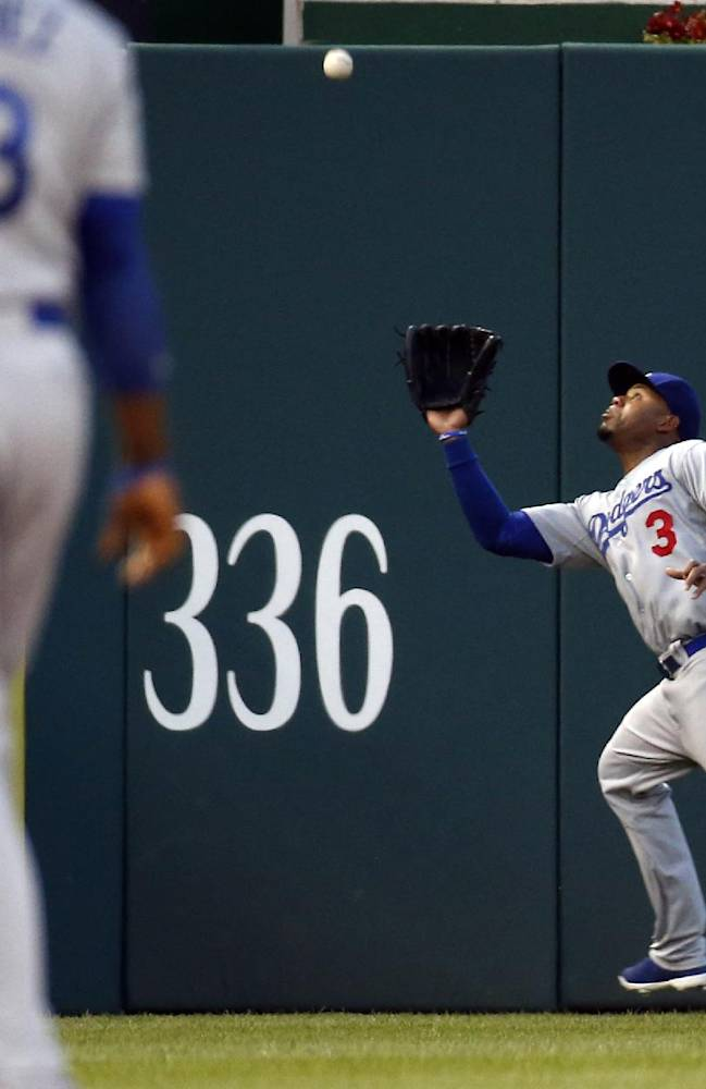 Los Angeles Dodgers left fielder Carl Crawford (3) catches a fly ball hit by Washington Nationals' Denard Span during the third inning of a baseball game at Nationals Park, Tuesday, May 6, 2014, in Washington
