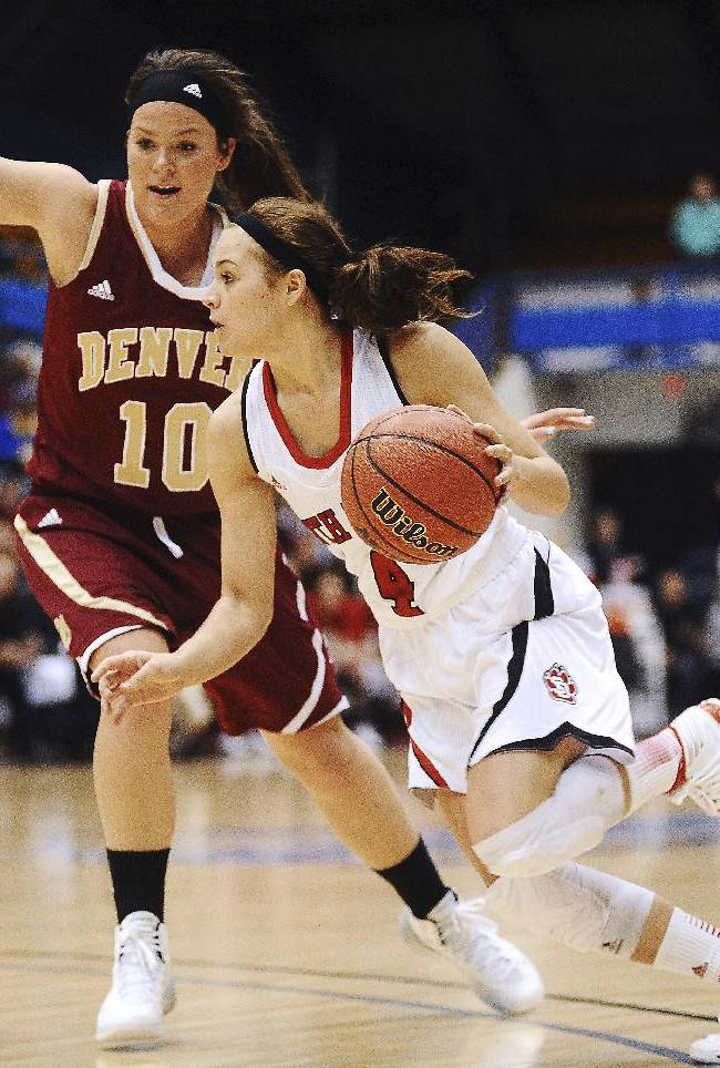 South Dakota's Tia Hemiller drives past Denver's Morgan Van Riper-Rose (10) during the first half of an NCAA college basketball game for the championship of the Summit League women's tournament Tuesday, March 11, 2014, in Sioux Falls, S.D. South Dakota won 82-71