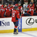 Washington Capitals center Nicklas Backstrom (19), from Sweden, celebrates his third goal for a hat trick with his teammates in the third period of an NHL hockey game against the Tampa Bay Lightning, Saturday, Dec. 13, 2014, in Washington. The Capitals wo