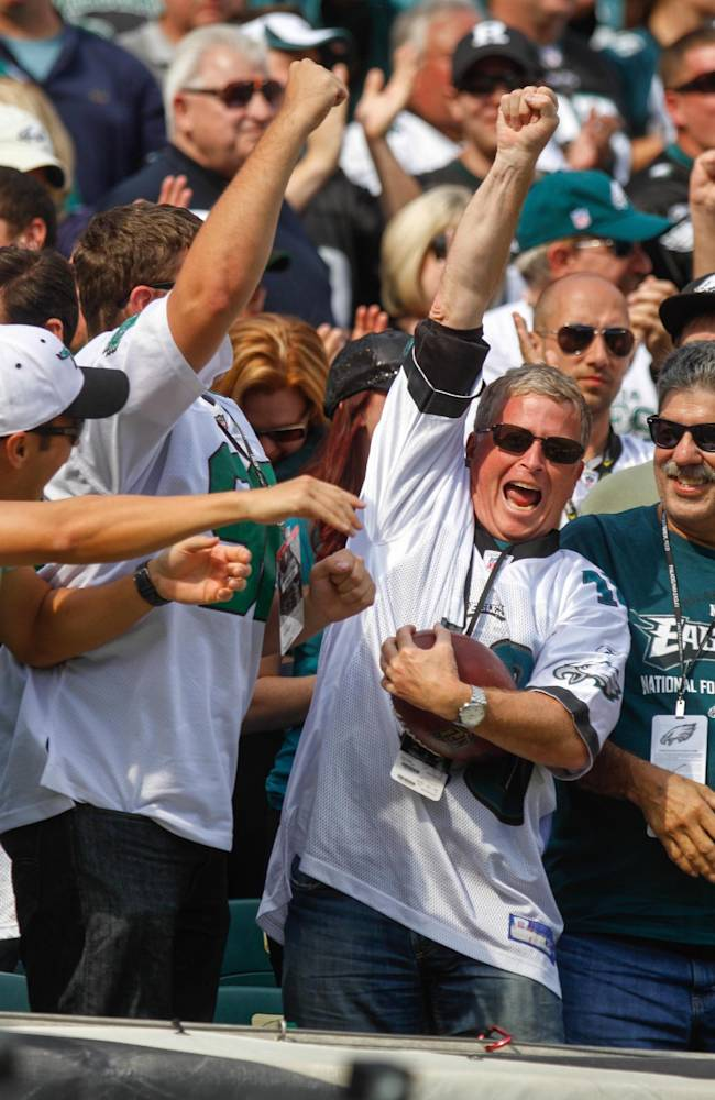 A Philadelphia Eagles fan celebrates after being thrown a football from Eagles' DeSean Jackson after his third quarter touchdown against the San Diego Chargers, Sunday, Sept. 15, 2013, in Philadelphia
