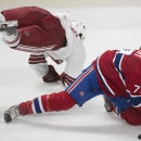 Montreal Canadiens' Tom Gilbert, right, collides with Arizona Coyotes' Sam Gagner during third period NHL hockey action in Montreal, Sunday, Feb. 1, 2015 The Associated Press