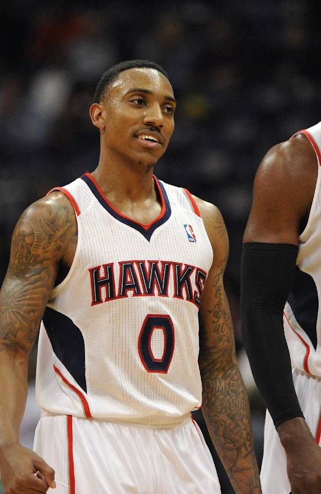 Atlanta Hawks guard Jeff Teague (0), who tied his career high with 34 points, and teammate Paul Millsap, who recorded his first career triple-double with 19 points, 13 rebounds and 2210 assists, walk off the court during overtime of their NBA basketball game against the Toronto Raptors Tuesday, March 18, 2014, in Atlanta. Atlanta won 118-113