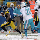 Pittsburgh Steelers wide receiver Antonio Brown (84) beats Miami Dolphins free safety Reshad Jones (20) and Miami Dolphins middle linebacker Dannell Ellerbe (59) and heads for the end zone after taking a pass from Pittsburgh Steelers quarterback Ben Roeth