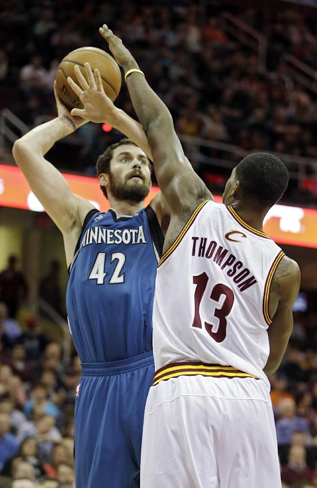Minnesota Timberwolves' Kevin Love (42) shoots against Cleveland Cavaliers' Tristan Thompson (13) in the first quarter of an NBA basketball game Monday, Nov. 4, 2013, in Cleveland