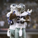 Dallas Cowboys' Dez Bryant (88) and DeMarco Murray (29) celebrate Murray's touchdown run against the New York Giants during the second half of an NFL football game, Sunday, Oct. 19, 2014, in Arlington, Texas. (AP Photo/Brandon Wade)