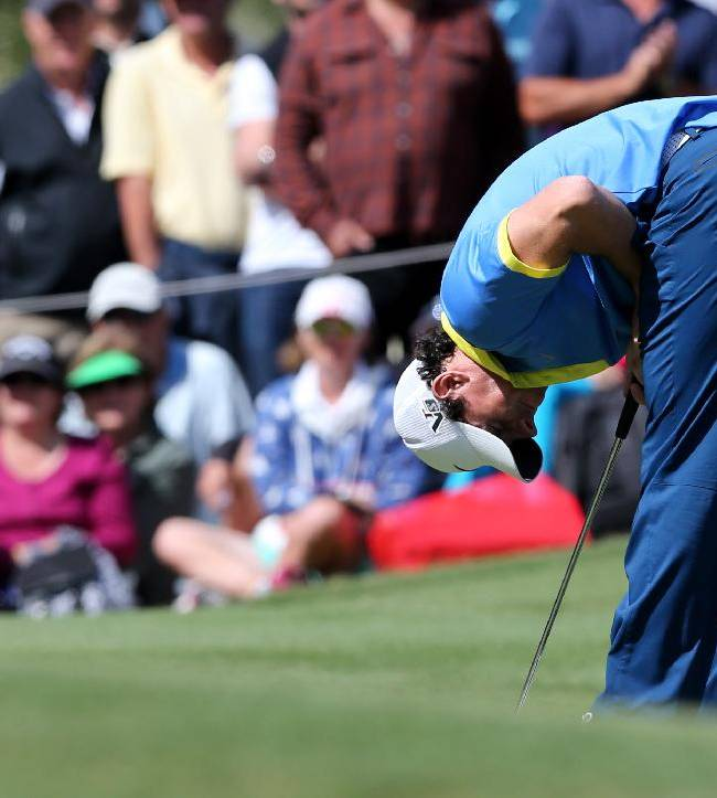 Rory McIlroy of Northern Ireland reacts after a missed putt during his third round of the Australian Open Golf tournament in Sydney, Australia, Saturday, Nov. 30, 2013