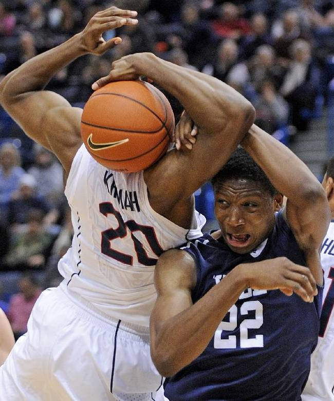 Connecticut's Lasan Kromah (20) fights for a rebound with Yale's Justin Sears during the first half of an NCAA college basketball game, in  Hartford, Conn., on Monday, Nov. 11, 2013