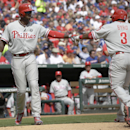 Philadelphia Phillies' Marlon Byrd (3) celebrates his home run with Domonic Brown (9) during the sixth inning of an opening day baseball game against the Texas Rangers at Globe Life Park, Monday, March 31, 2014, in Arlington, Texas The Associated Press