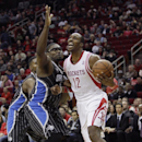 Houston Rockets power forward Dwight Howard (12) is fouled by Orlando Magic's Jason Maxiell (54) as he attempts to drive during the second half of an NBA basketball game on Sunday, Dec. 8, 2013, in Houston The Associated Press